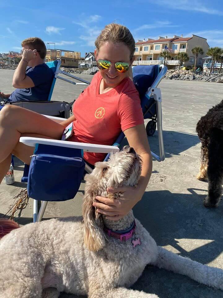 BTF customer petting her dog on the beach